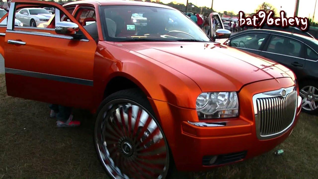 Candy Orange Chrysler 300C Lifted On 30 DUB Swyrls
