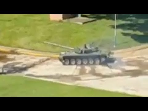 Tank and armoured vehicles respond to attack in Venezuela military base