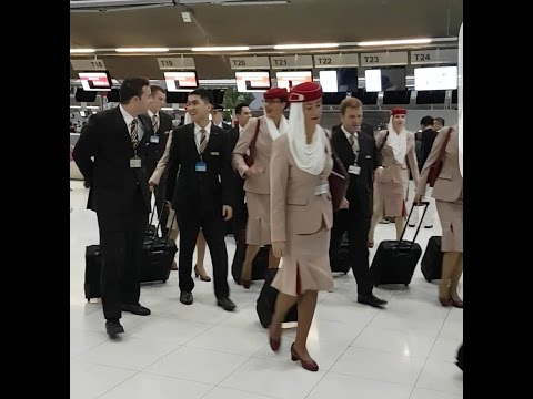 EMIRATES Cabin Crew walking at Suvarnabhumi Airport, Bangkok, Thailand (July, 8 2016)