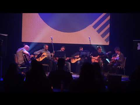 Fingerstyle Guitar students play U2's With or Without You at the Belfast Guitar Night