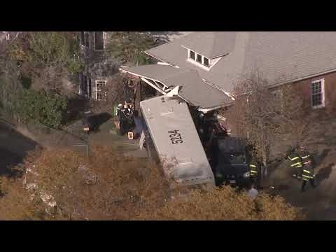 Bus slams into Denver home