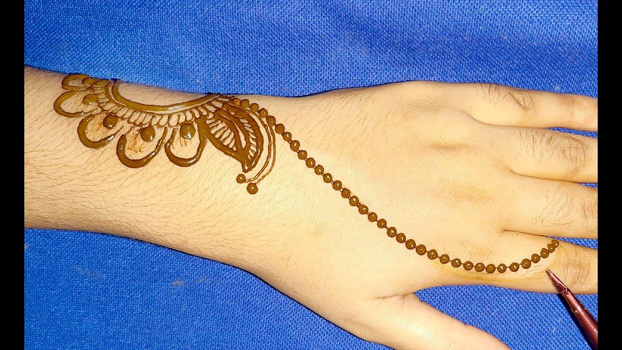 very easy back hand mehndi design-easy Arabic gol tikki mehndi-Eid/Rakhi special mehandi design