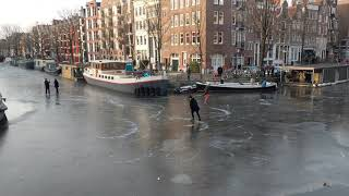 People Ice Skating on Amsterdam Canals 2018