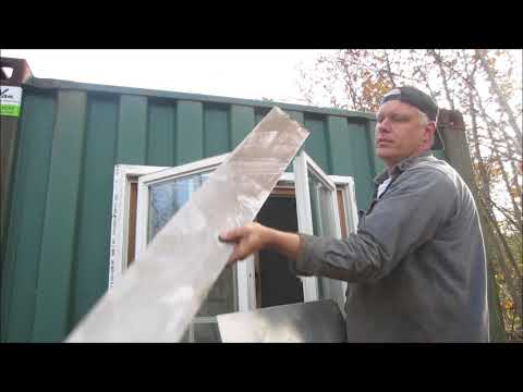 shipping container garage gets a window hacked in.