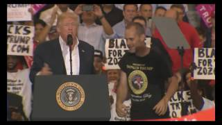 donald trump brings supporter on stage at rally in melbourne florida