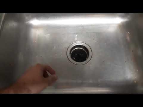 unclogging-a-garbage-disposal