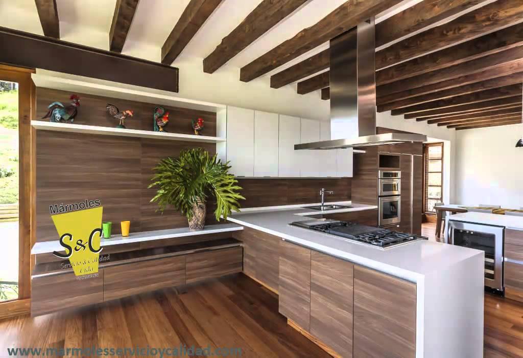 Marmoles servicio y calidad fachadas pisos mesones de for Modelos de pisos de cocina