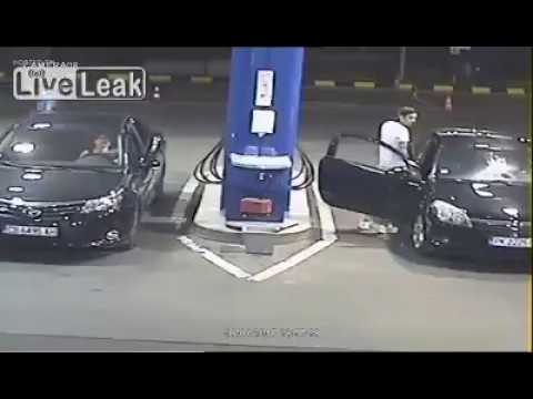 Gas Station Worker Sprays Cigarette Smoker with Fire Extingu