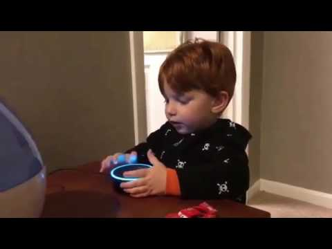 Kid trying out Alexa to play