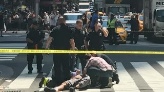 Several hurt after car drives onto sidewalk in Times Square