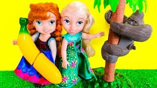 Elsa and Anna toddlers feed cute zoo animal pets