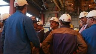 Macron visits French shipyard to push labour reform