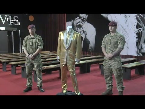 Elvis's Goldsuit Arrives In London By Armoured Vehicle