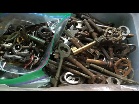 Selling the gold watch looking Through antique keys Getting ready for the flea market blue Bus Dave