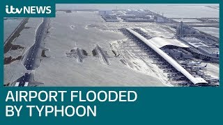 Typhoon slams into western Japan, flooding airport | ITV News