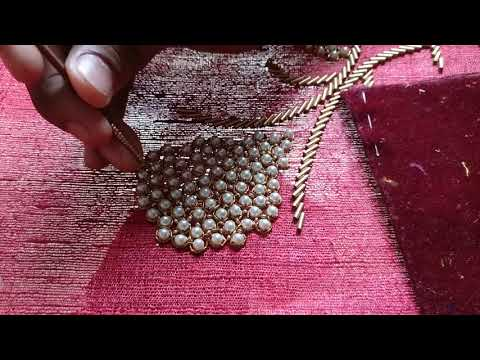 Placing sugar beads among big white pearls