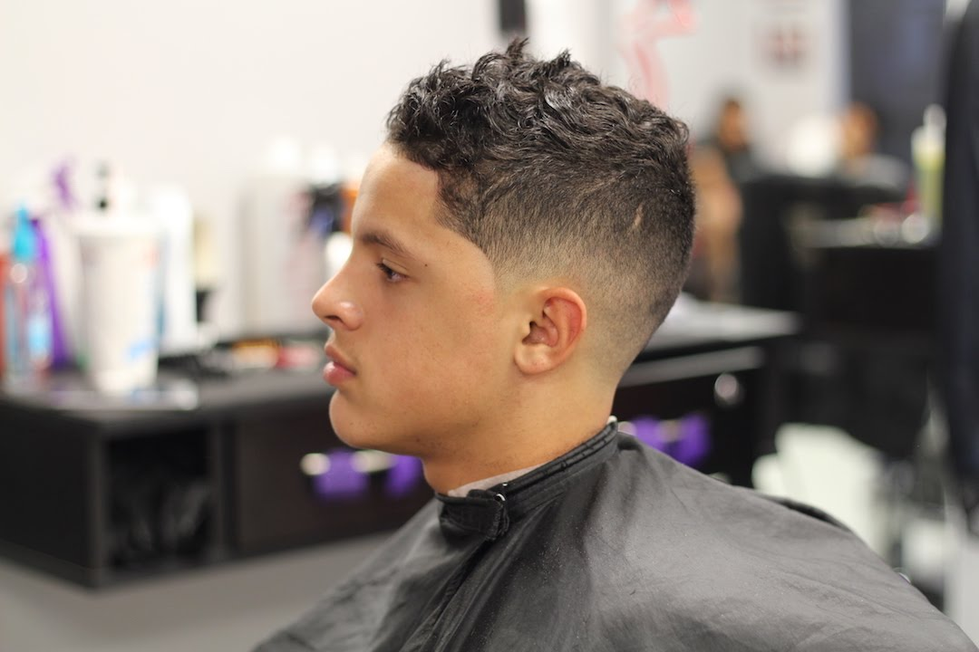 bald skin fade with long curly