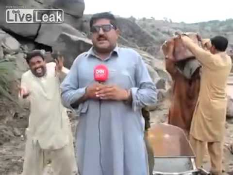 Interviewer laughing on news reporter on live reporting in P