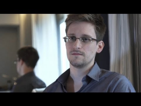 """You're Being Watched"": Edward Snowden Emerges as Source Behind Explosive Revelations of NSA Spying"