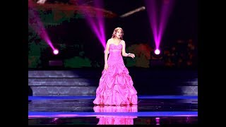 Chelsea Snow sings 千年 之 约 at the National Aquatics Center in Beijing, China..