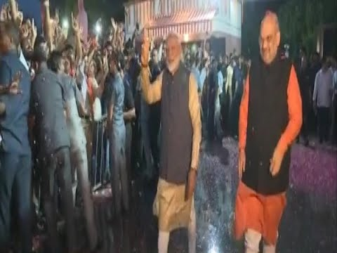 Delhi: PM Modi waves at BJP supporters in party office