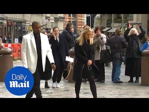 Kanye West wears bright white blazer to fashion memorial - Daily Mail