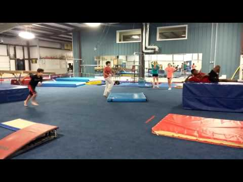 Back flip off the wall.  Parents Night Out at Basel's Gym.