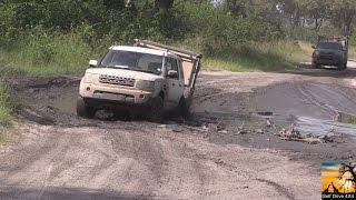 Towing Caravan In Moremi Botswana. Mud And Water.