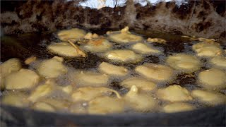 Closeup shot of pakoras (fritters) being prepared in hot oil for guests at the Indian wedding