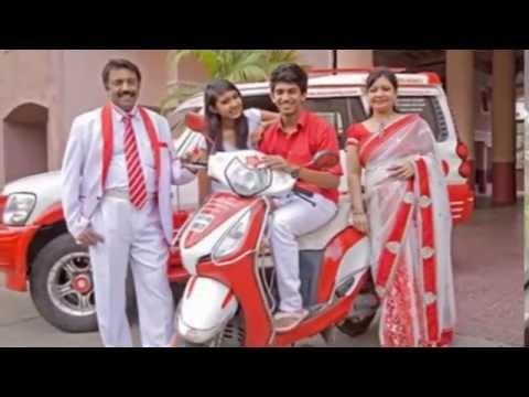 Bangalore real estate agent surrounds himself with the colours red and white to satisfy his crazy