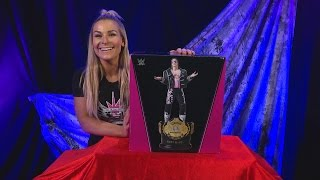 Natalya unboxes the Bret Hart Championship Title Collection Statue from WWE Shop