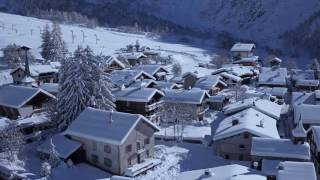 Chamonix Mont-Blanc in Winter (aerial drone stock footage of snowy Alpine mountains)