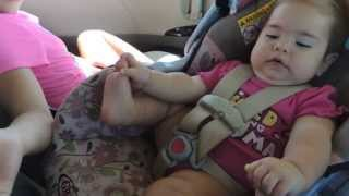 cute 9 mth old baby kicking her legs and baby talking