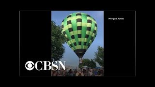 Hot air balloon crashes into festival crowd