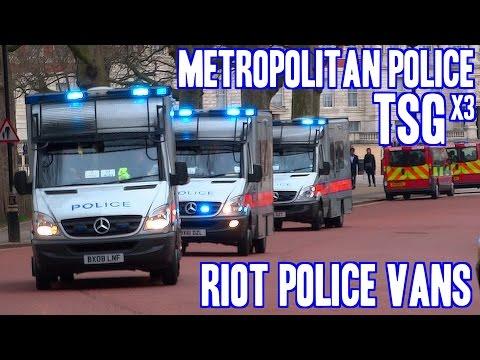 Metropolitan Police Territorial Support Group riot vans (x3) Mercedes Sprinters urgently responding
