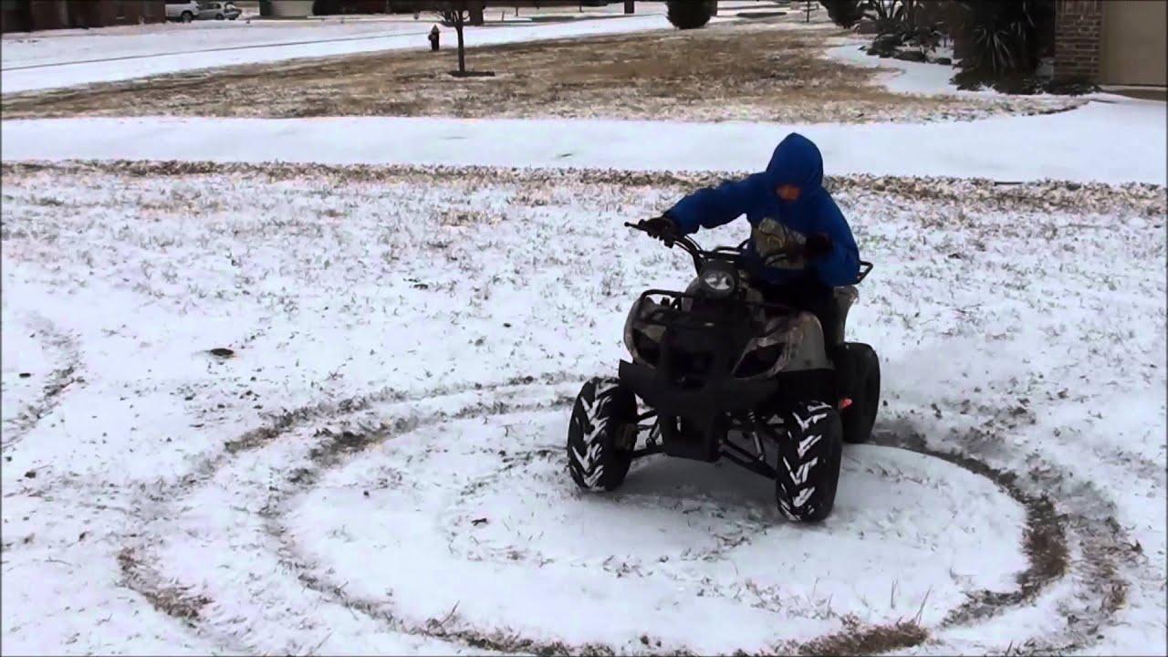 ATV in the Snow - ATA-125D - YouTube