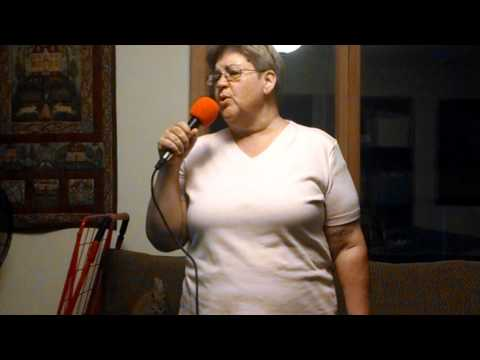 Sharon B. Doing a popular karaoke song.
