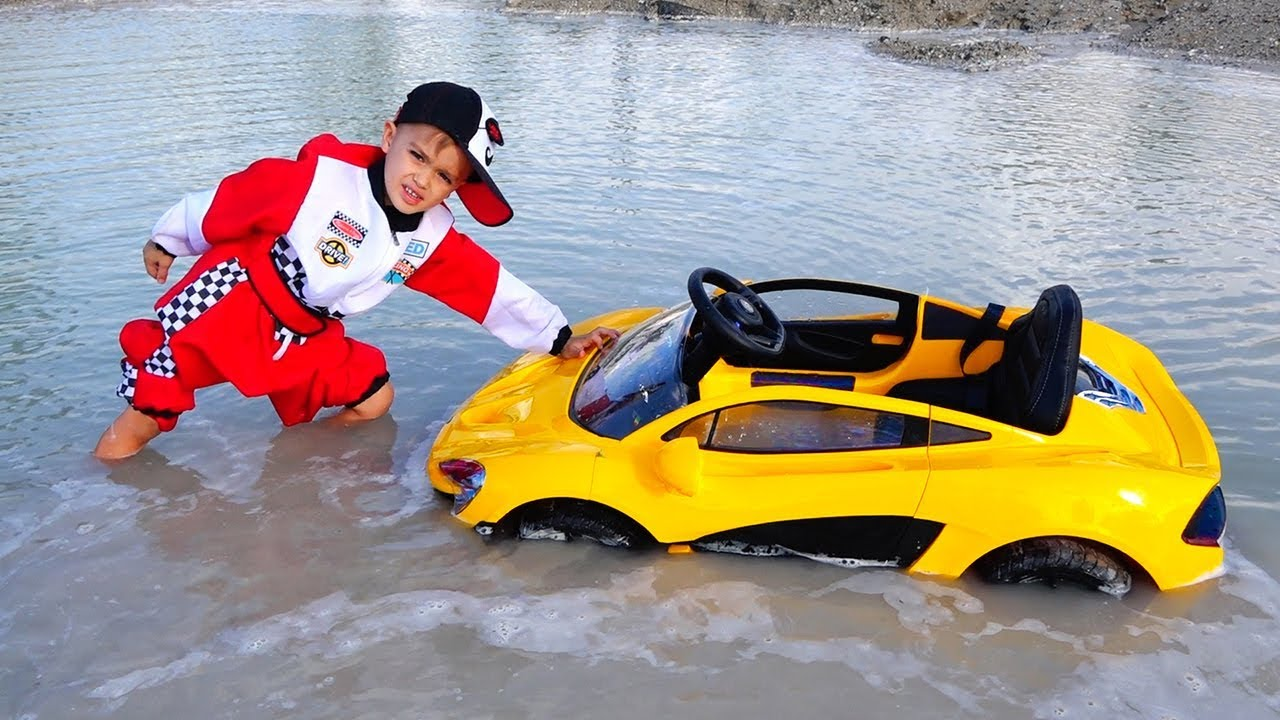 Download Nikita ride on children's car and stuck in a puddle