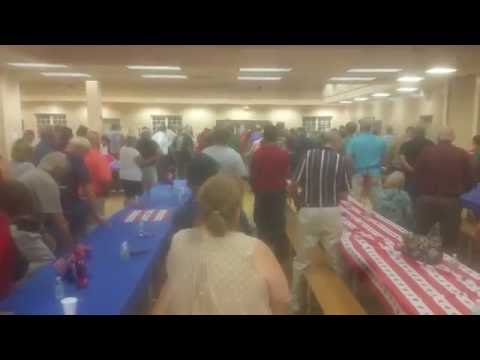 Choir singing to veterans at Villages Charter School