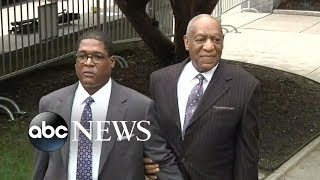 Topless protester confronts Bill Cosby