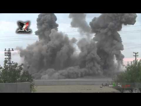 U.S. warplanes targeting a hill under control of ISIS in Ayn al-Arab.
