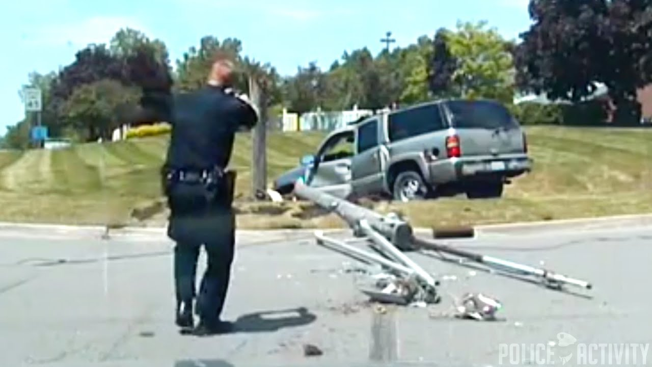 Woman Crashes SUV Into Utility Pole After Police Chase