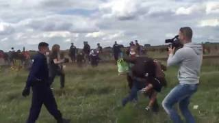 VIDEO: Camerawoman for N1TV trips a refugee carrying a small child as he runs from police