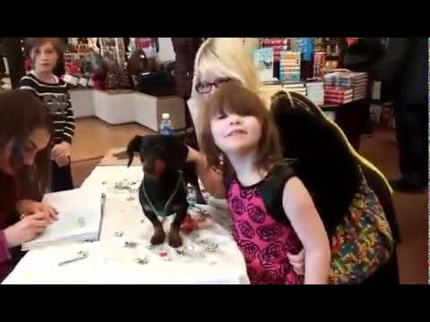 A Fan Brings Crusoe a Present at One of His Book Signings