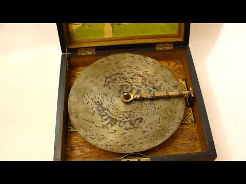 A late 19th century walnut cased disc musical player