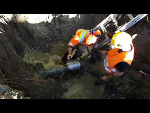 Water main break repair under pressure