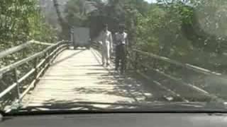 Crossing A Wooden Plank Cable Suspension Bridge