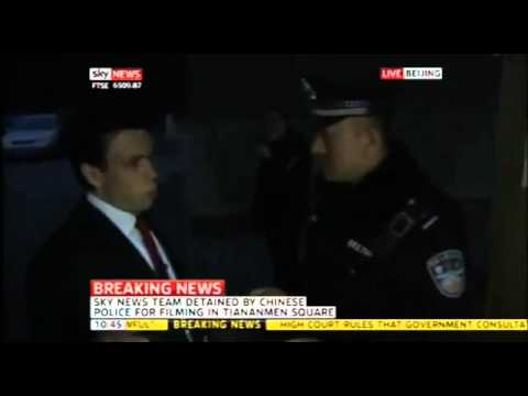 Lcalls - UK reporter broadcasts LIVE from China while detained by state cops.(HD)