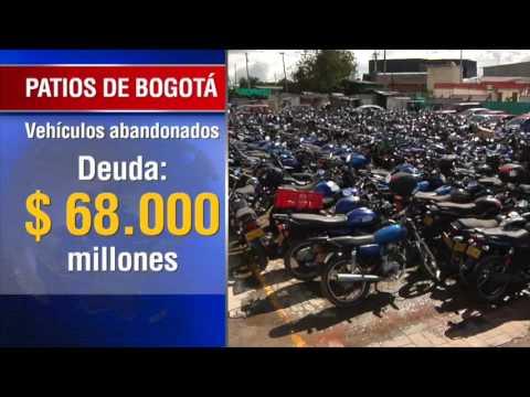 Carros y motos abandonados en patios de Bogotá serán vendidos este año