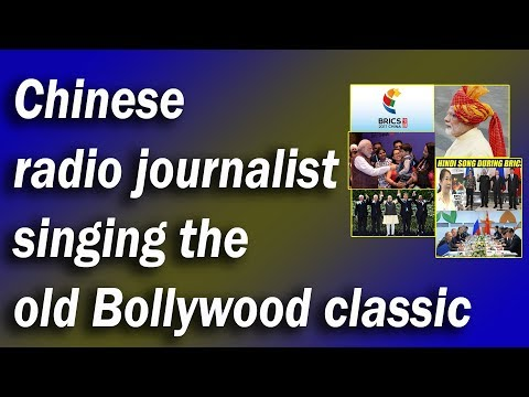 Chinese radio journalist singing the  old Bollywood classic
